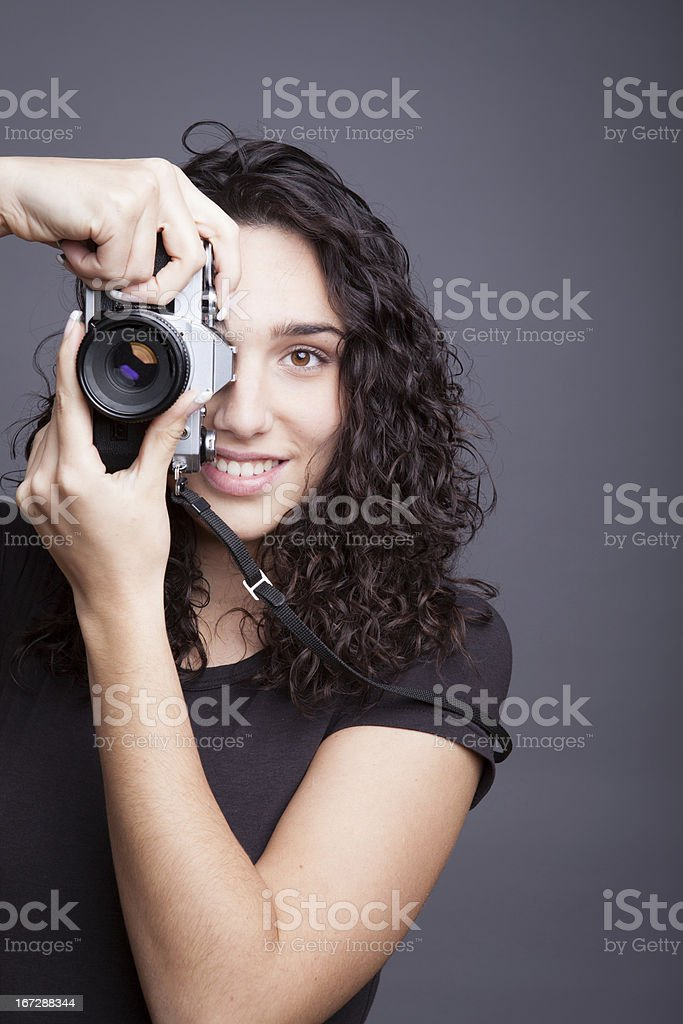 Woman photographer with camera royalty-free stock photo