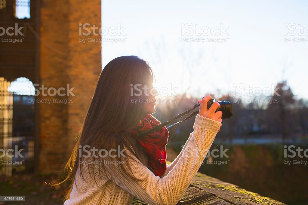 Woman photographing at sunset stock photo