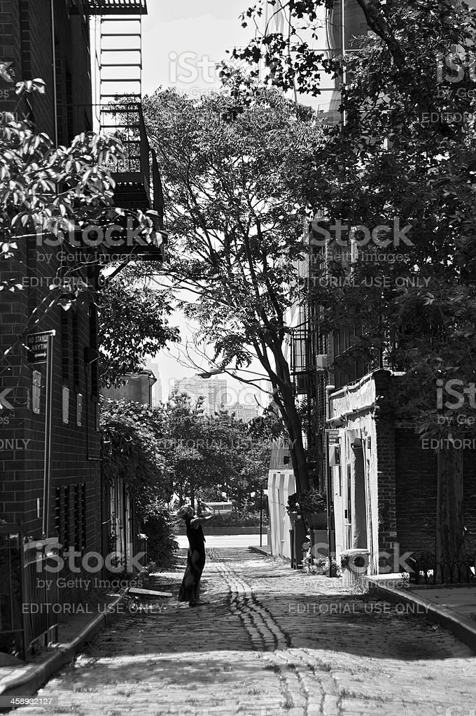 Woman photographing historic street, Greenwich Village, New York City royalty-free stock photo