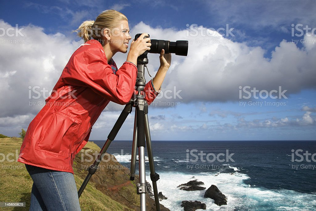 Woman photographing in Hawaii. stock photo