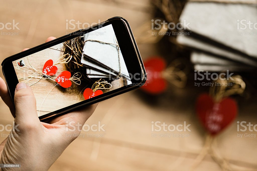 Woman photographing love letters stock photo