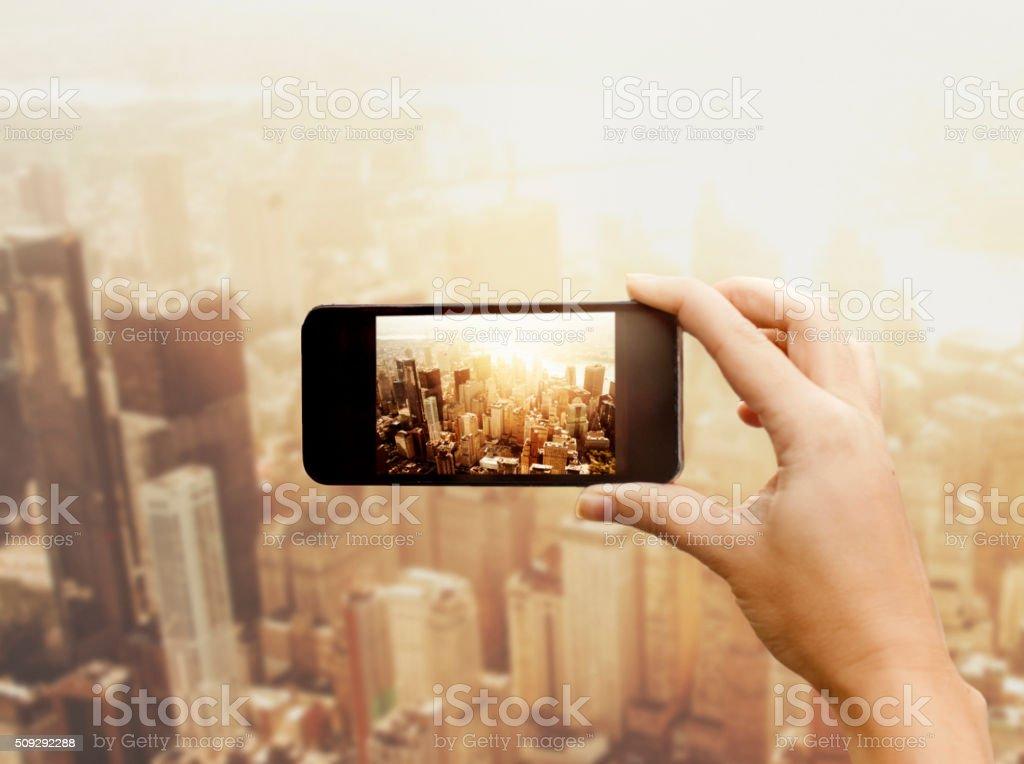 Woman photographing New York City stock photo