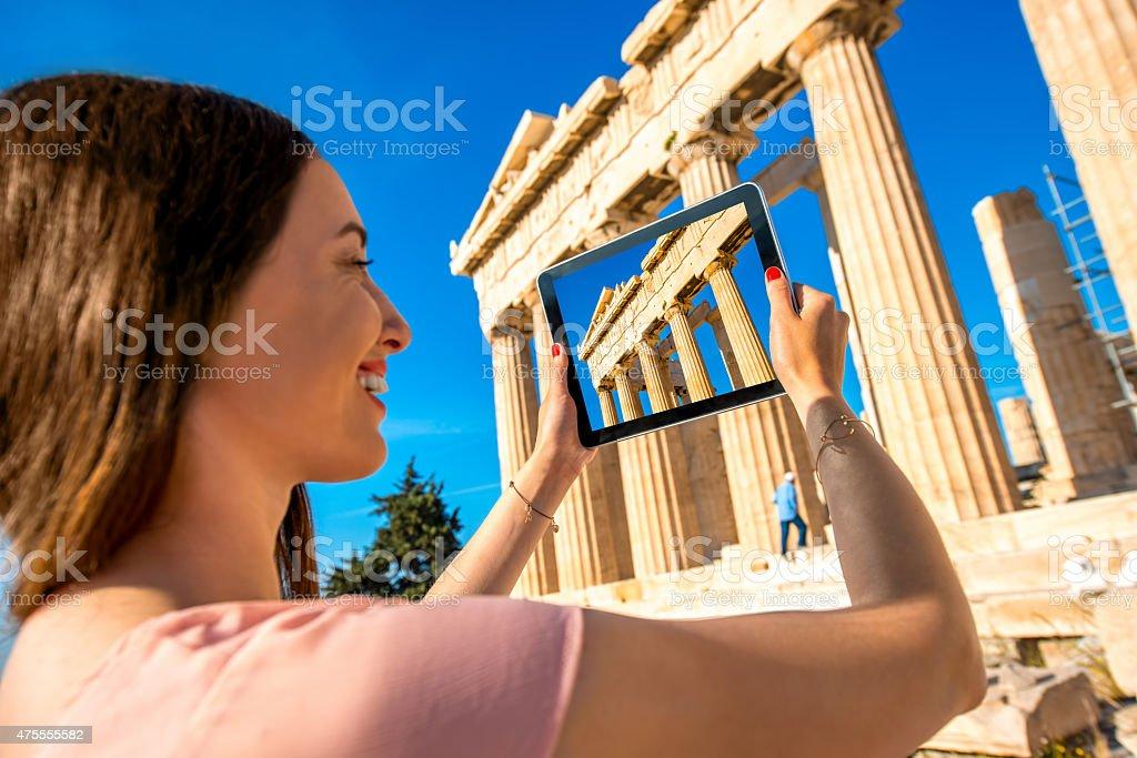 Woman photographing Parthenon temple in Acropolis stock photo