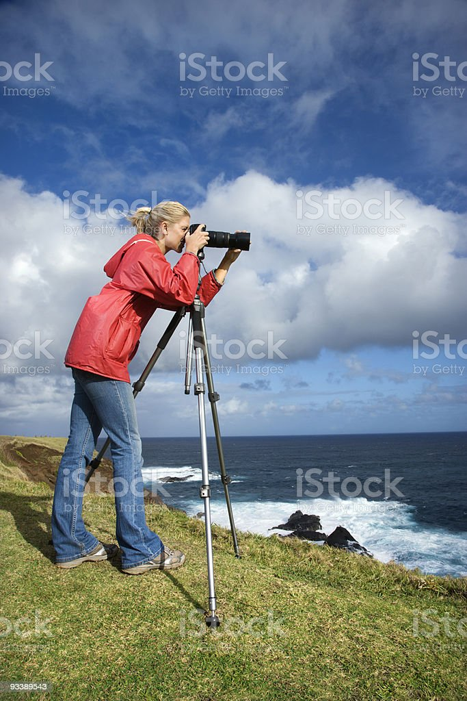 Woman photographing scenery in Maui, Hawaii. royalty-free stock photo