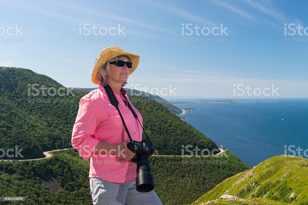 Woman photographing, Skyline, Cabot trail, Cape Breton, Nova Scotia stock photo