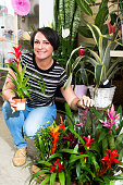 Woman picking a bromelia flower