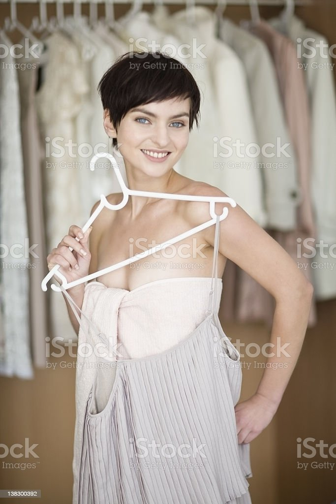 Woman picking clothes from closet stock photo