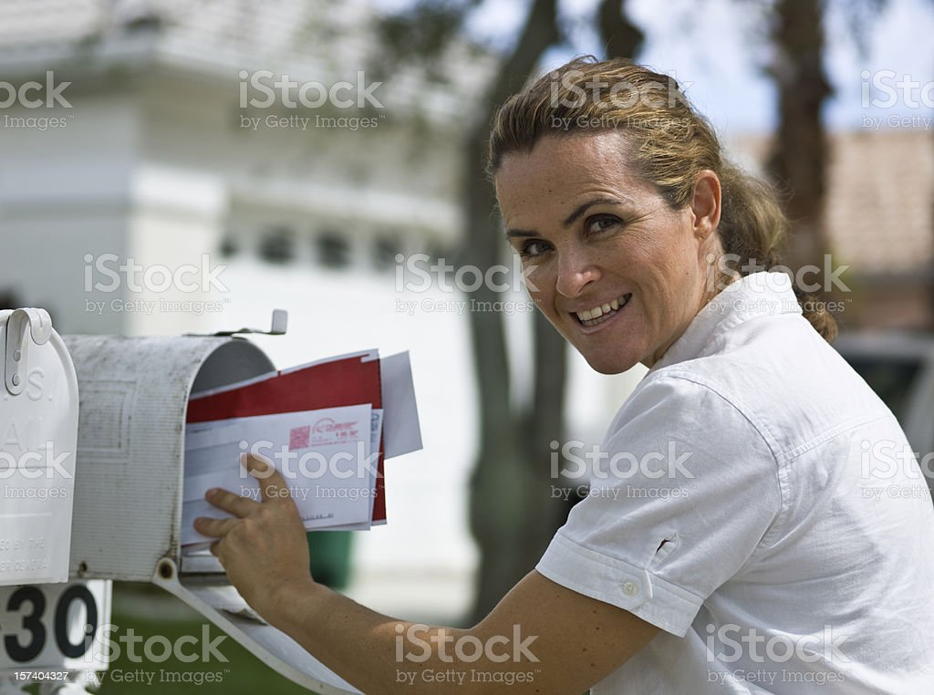 Woman picking up the mail royalty-free stock photo