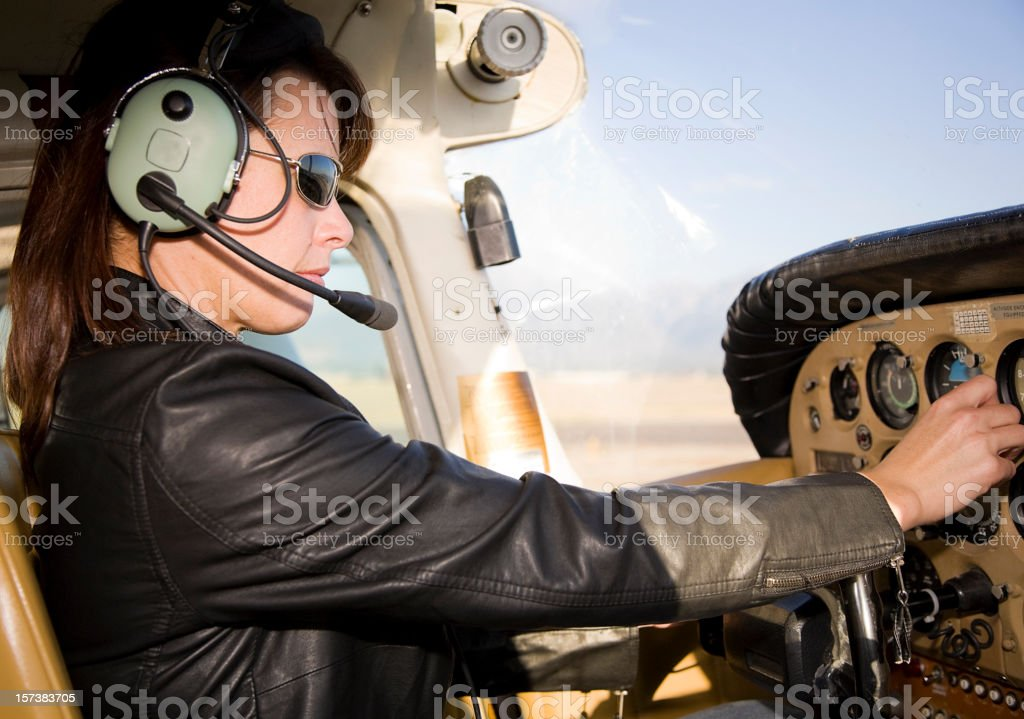 Woman Pilot in an Airplane royalty-free stock photo