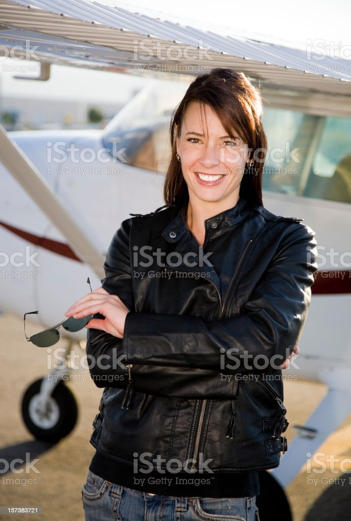 Woman Pilot Standing Next to an Airplane royalty-free stock photo