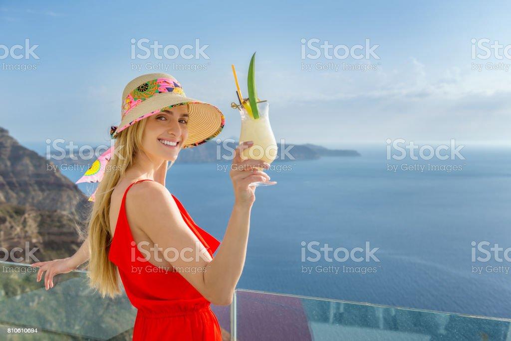 Woman & pina colada stock photo