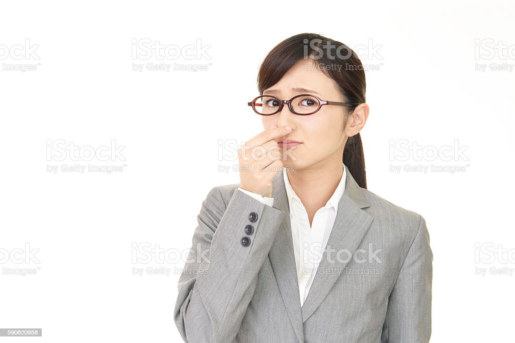 Woman pinches her nose stock photo