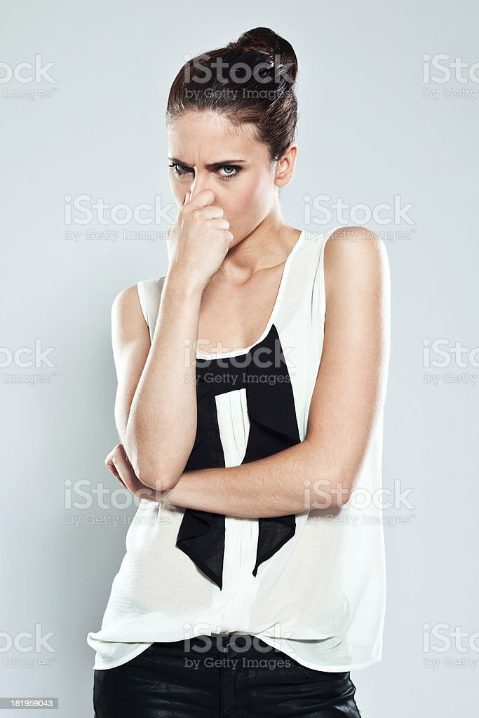 Woman pinches nose royalty-free stock photo