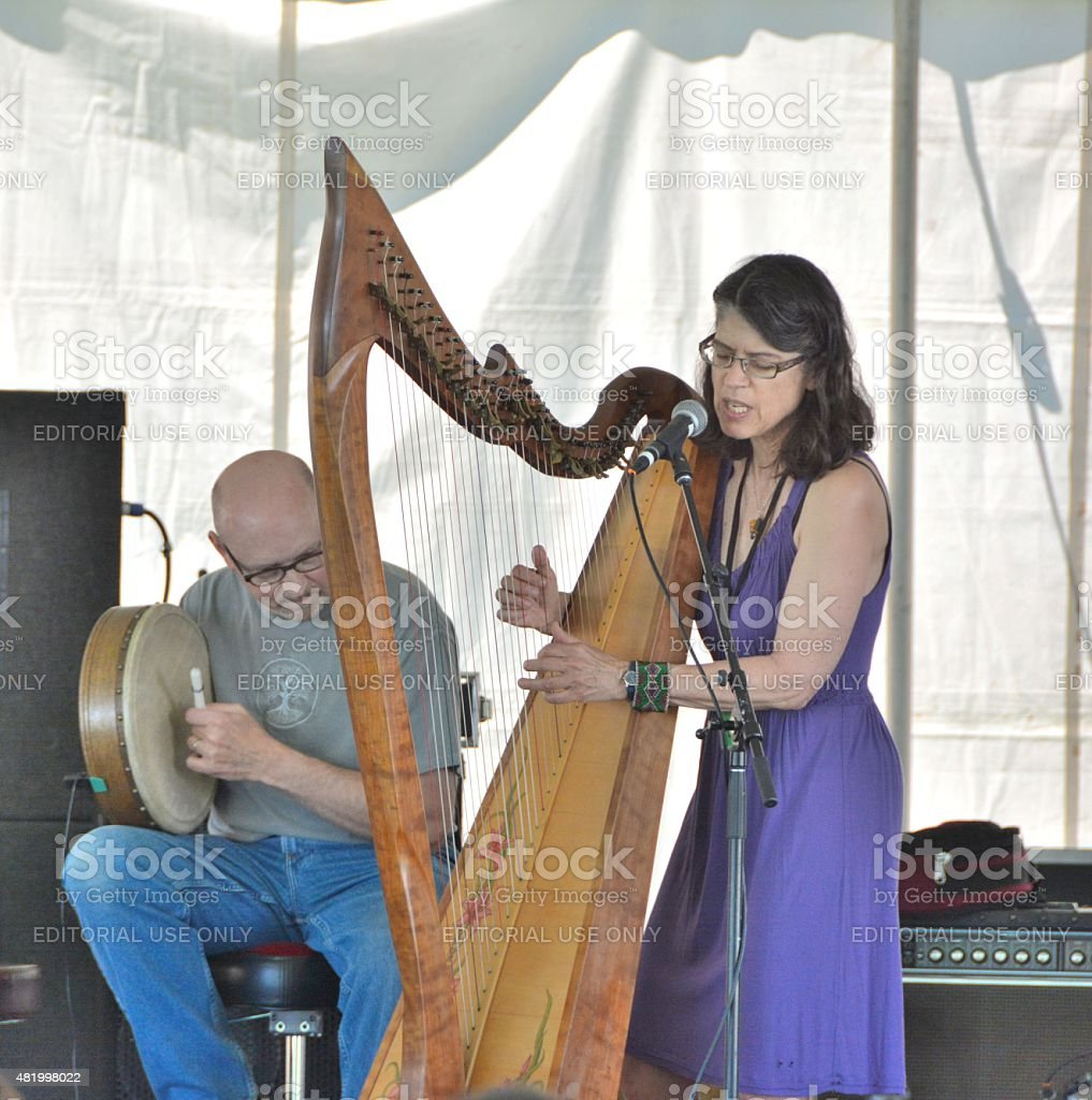 Woman plaing the Harp stock photo