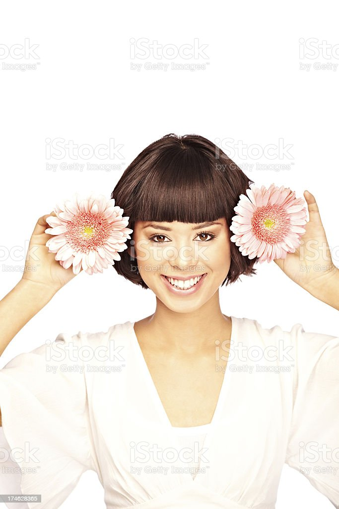 Woman Playfully Holding Flowers by her Head royalty-free stock photo