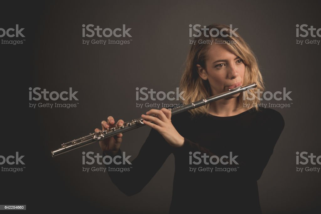 Woman Playing a Flute stock photo