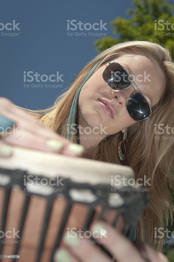 Woman playing a hand drum. stock photo