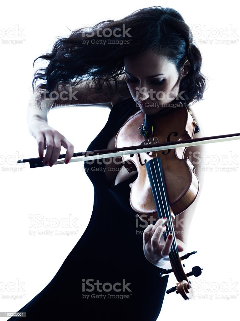 A woman playing a violin with hair flowing stock photo