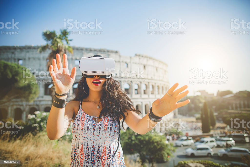 Woman playing augmented reality with VR headset stock photo