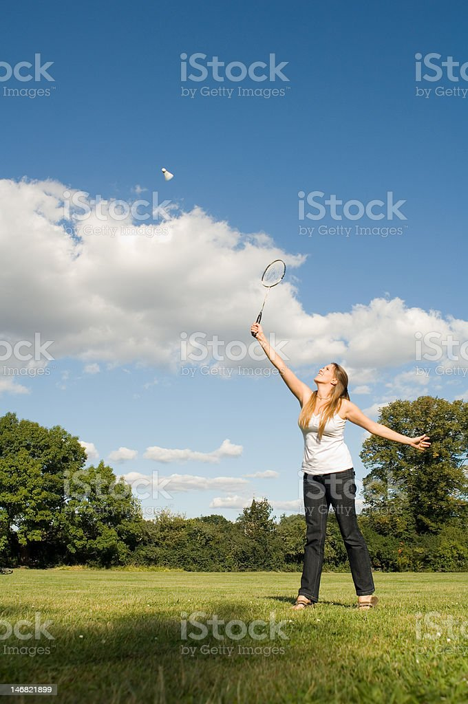 Woman playing Badminton at park stock photo