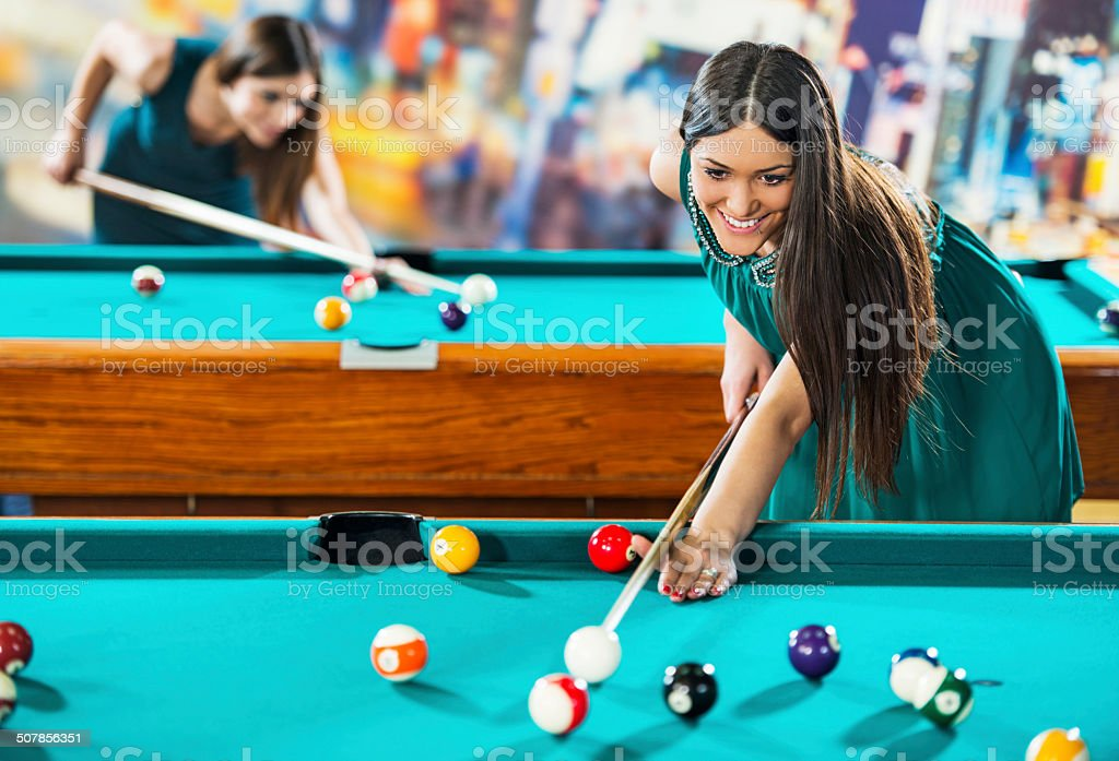 Woman playing billiard. royalty-free stock photo