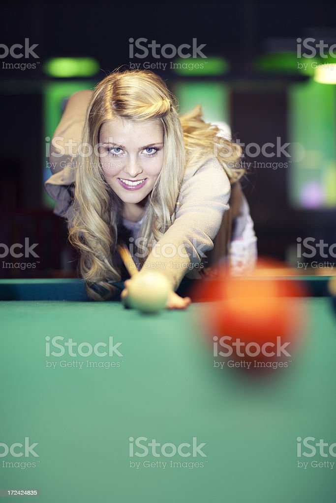Woman  playing billiards snooker royalty-free stock photo