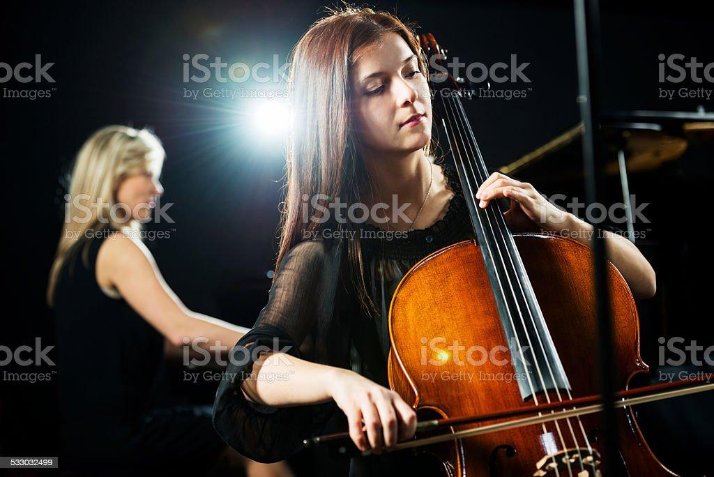 Woman playing cello. stock photo