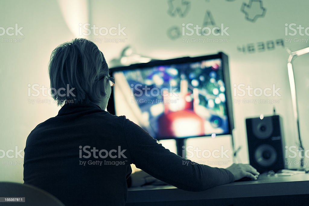 Woman playing computer games stock photo