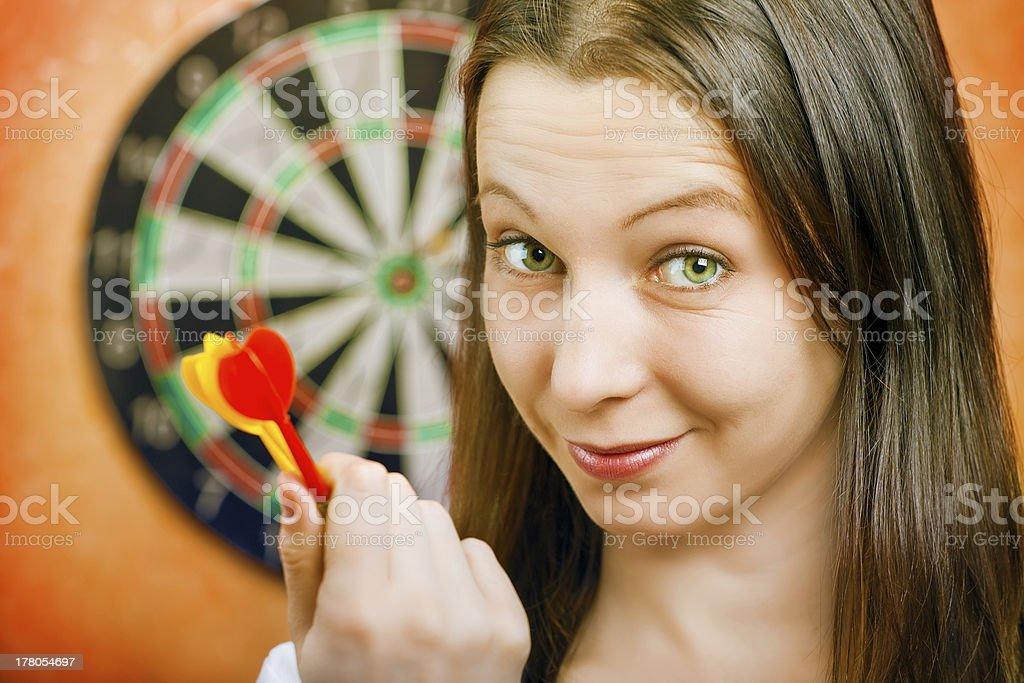 woman playing darts royalty-free stock photo