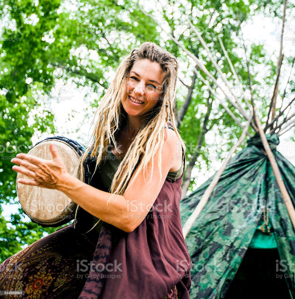 Woman Playing Djembe Drum stock photo