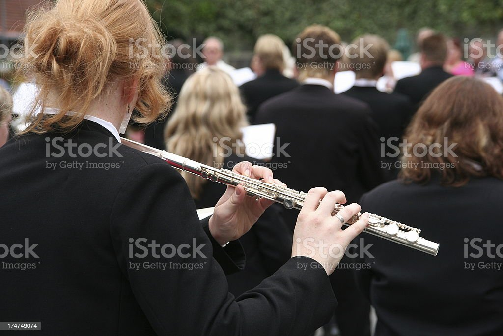 woman playing  flute at a parade in germany royalty-free stock photo
