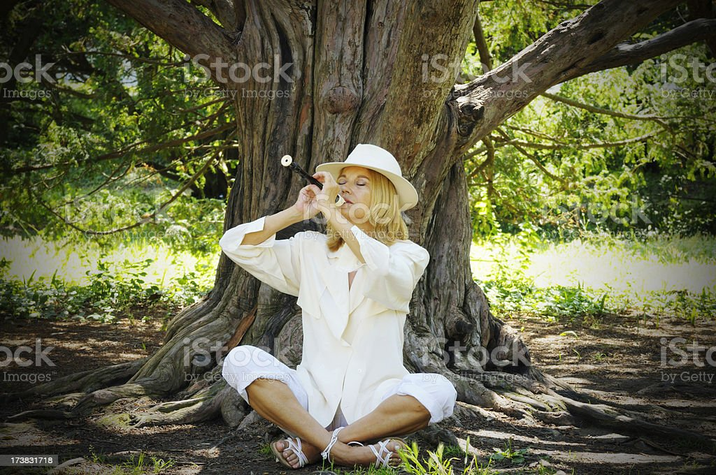 Woman playing flute royalty-free stock photo