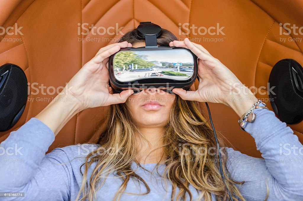 Woman playing game in virtual reality glasses stock photo