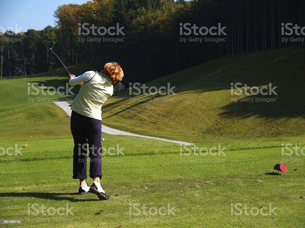 Woman playing golf 2 stock photo