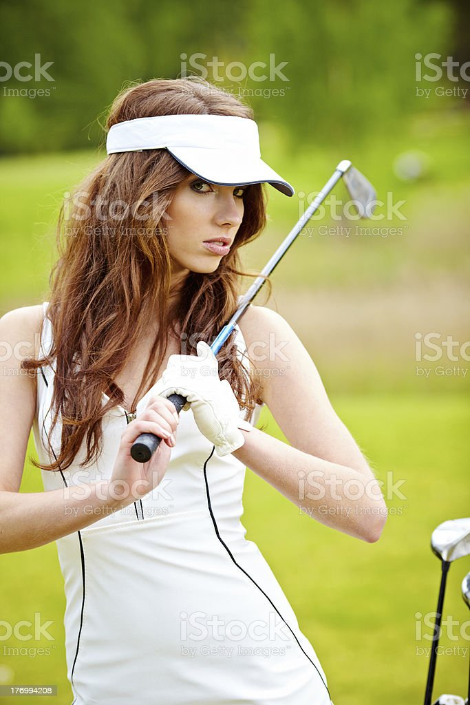 woman playing golf on a green royalty-free stock photo