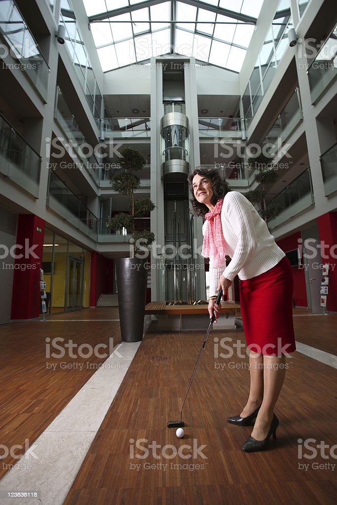 Woman playing golf royalty-free stock photo