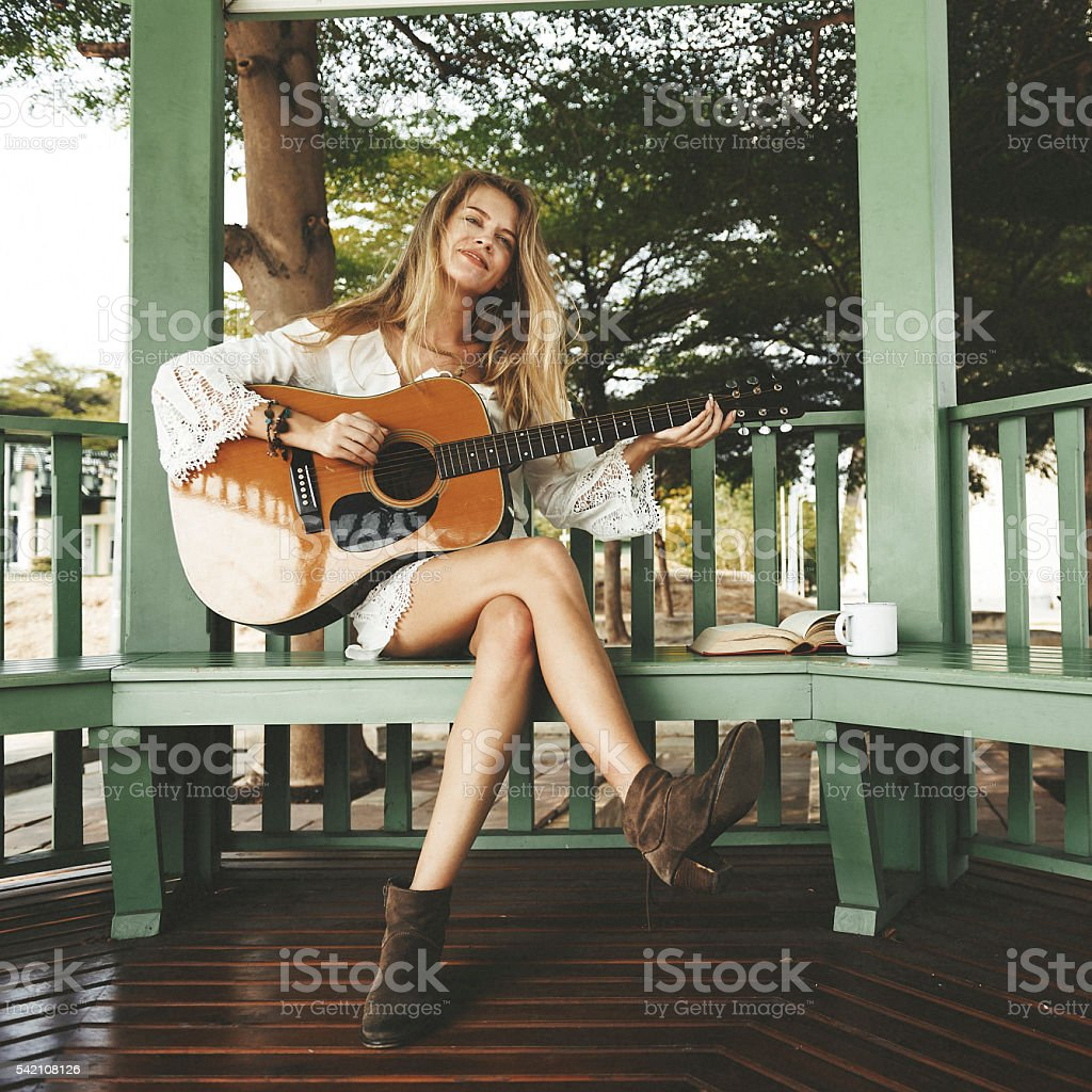 Woman Playing Guitar Music Beautiful Concept stock photo