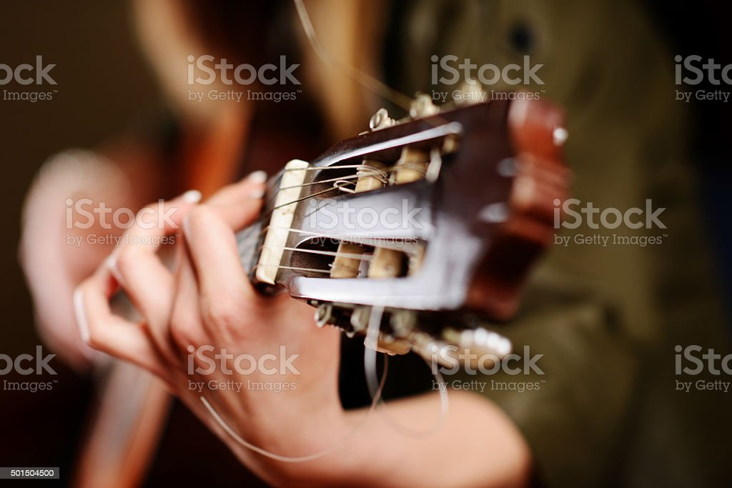 Woman playing guitar stock photo