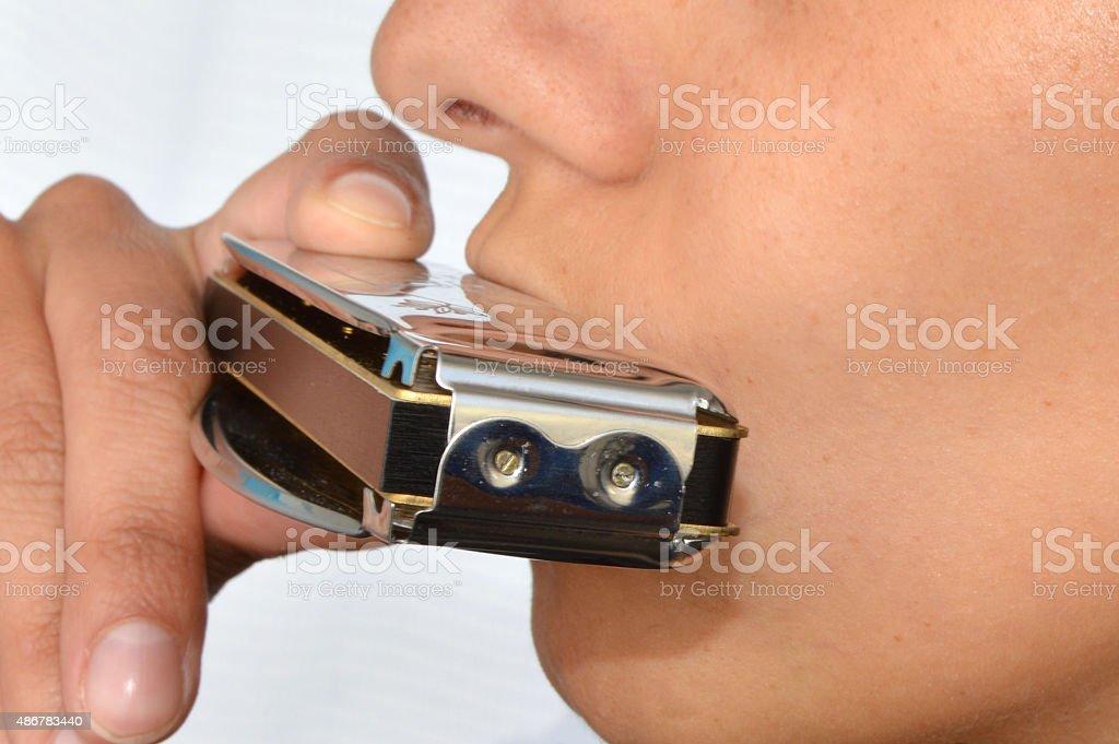 woman playing harmonica stock photo