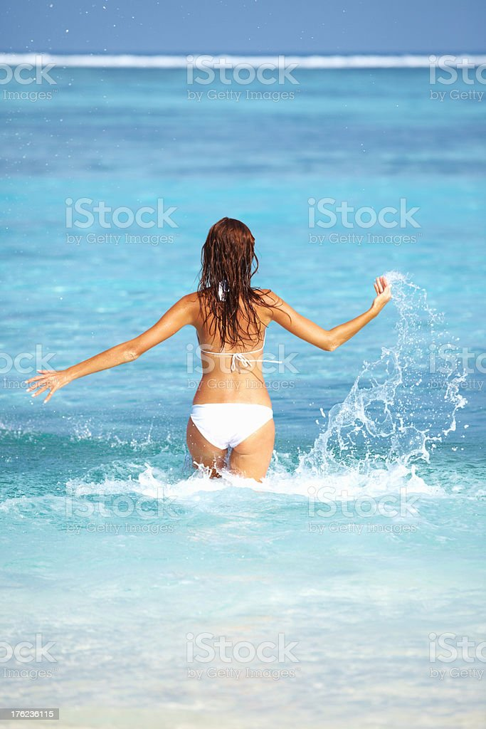 Woman playing in water stock photo