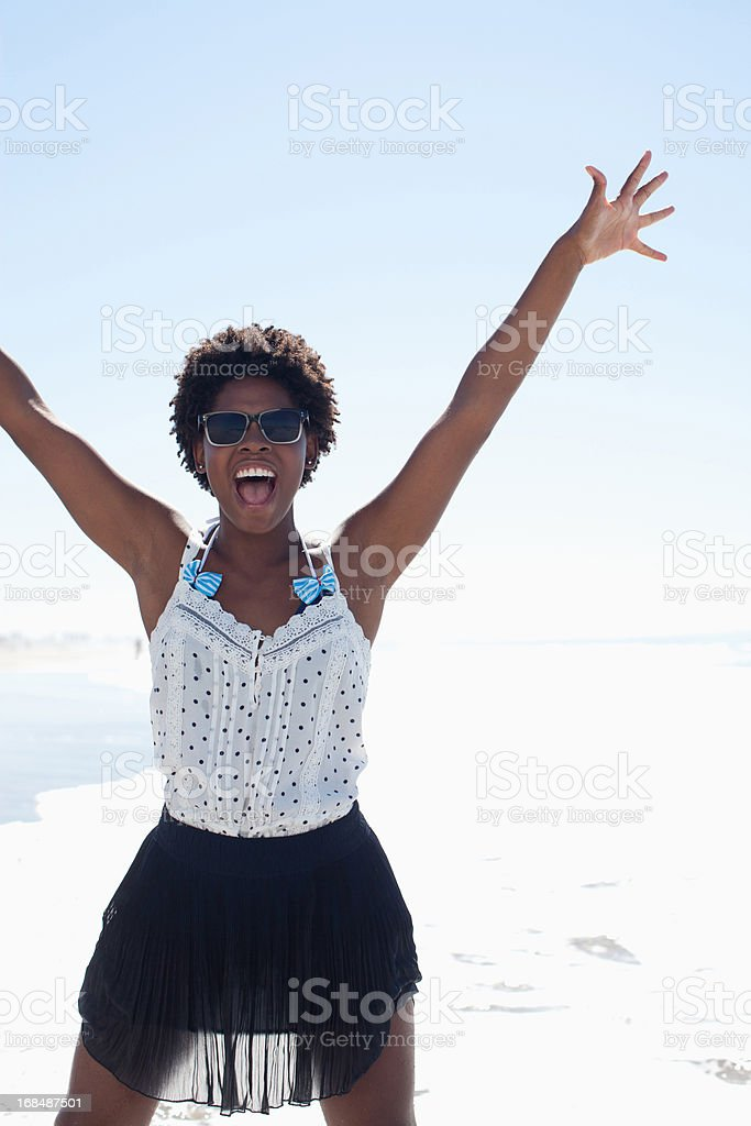 Woman playing in waves on beach royalty-free stock photo