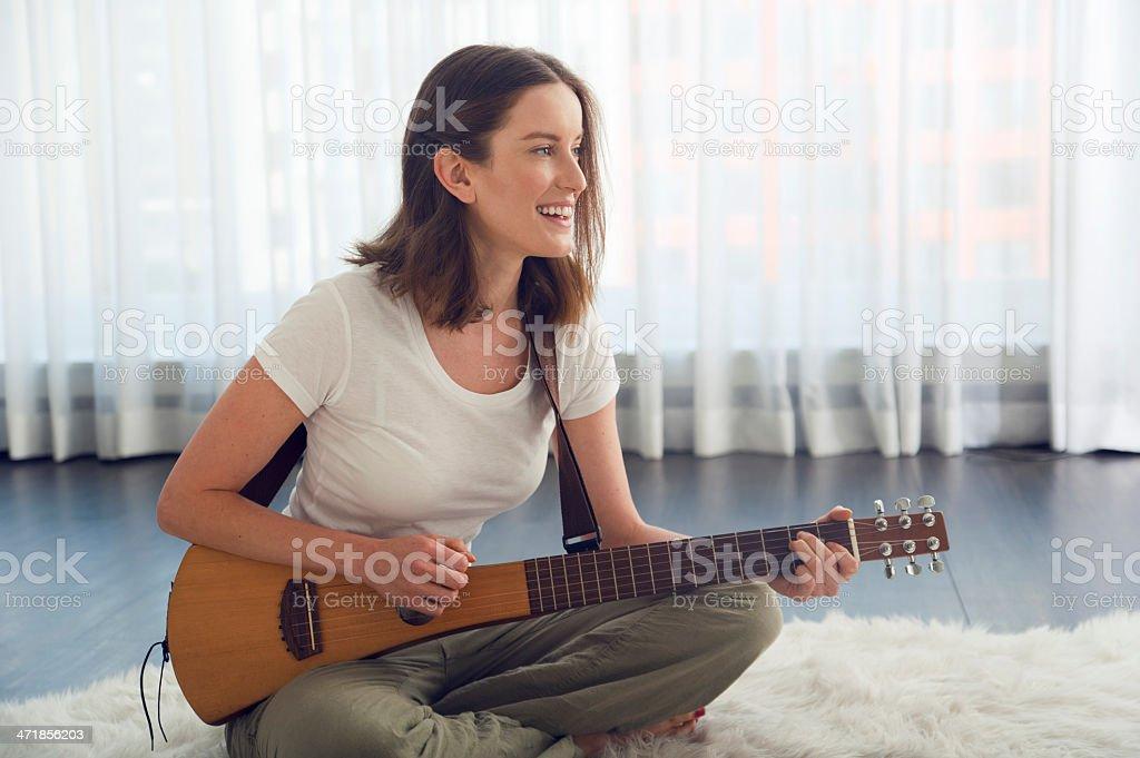 Woman playing music royalty-free stock photo