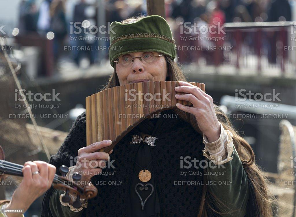 woman playing panflute stock photo