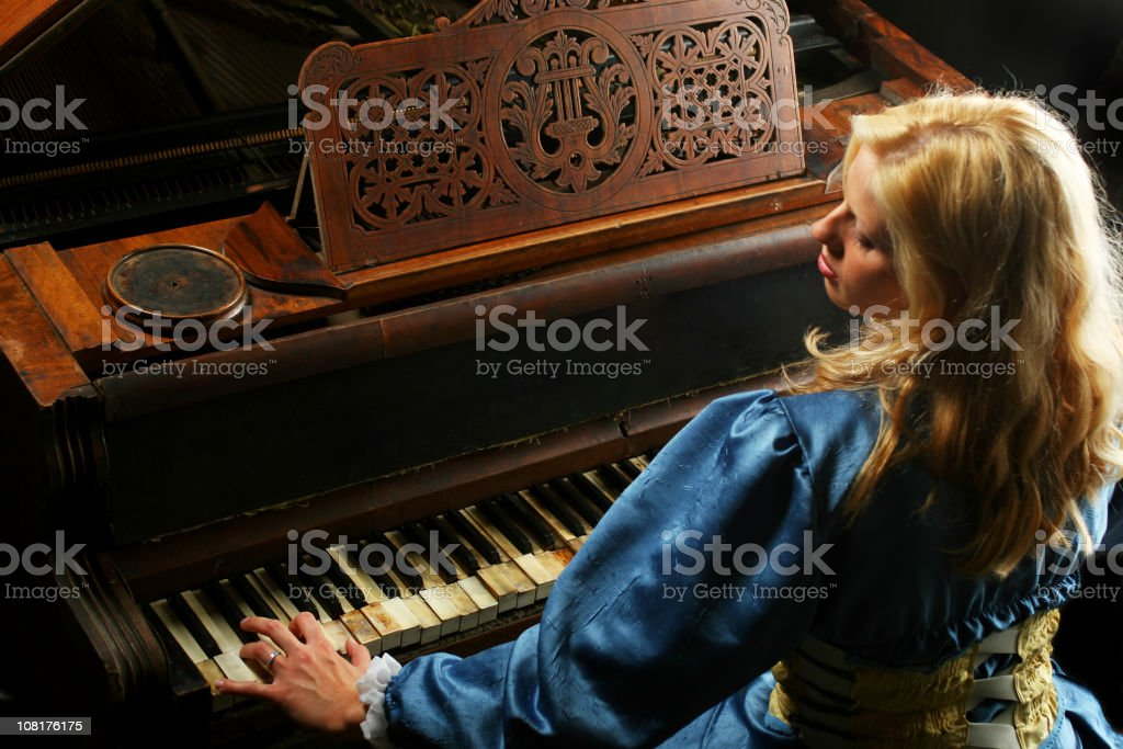 Woman Playing Piano royalty-free stock photo