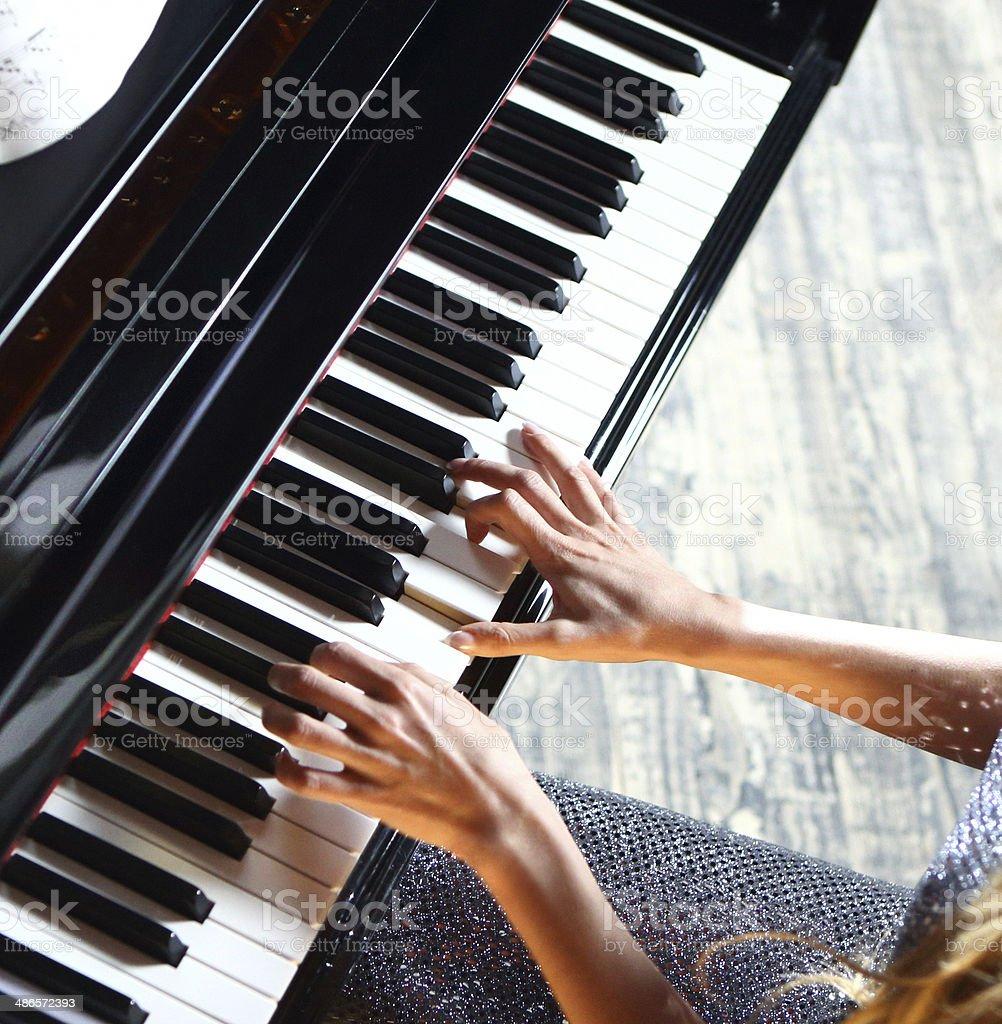 Woman playing piano. royalty-free stock photo