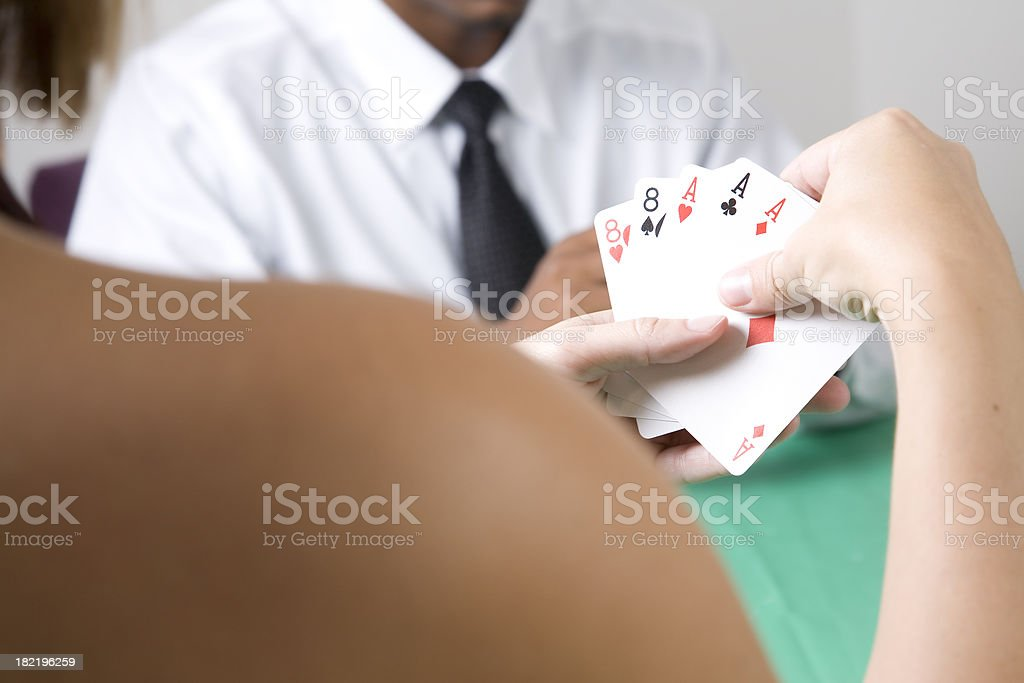 Woman Playing Poker and Holding a Full House stock photo