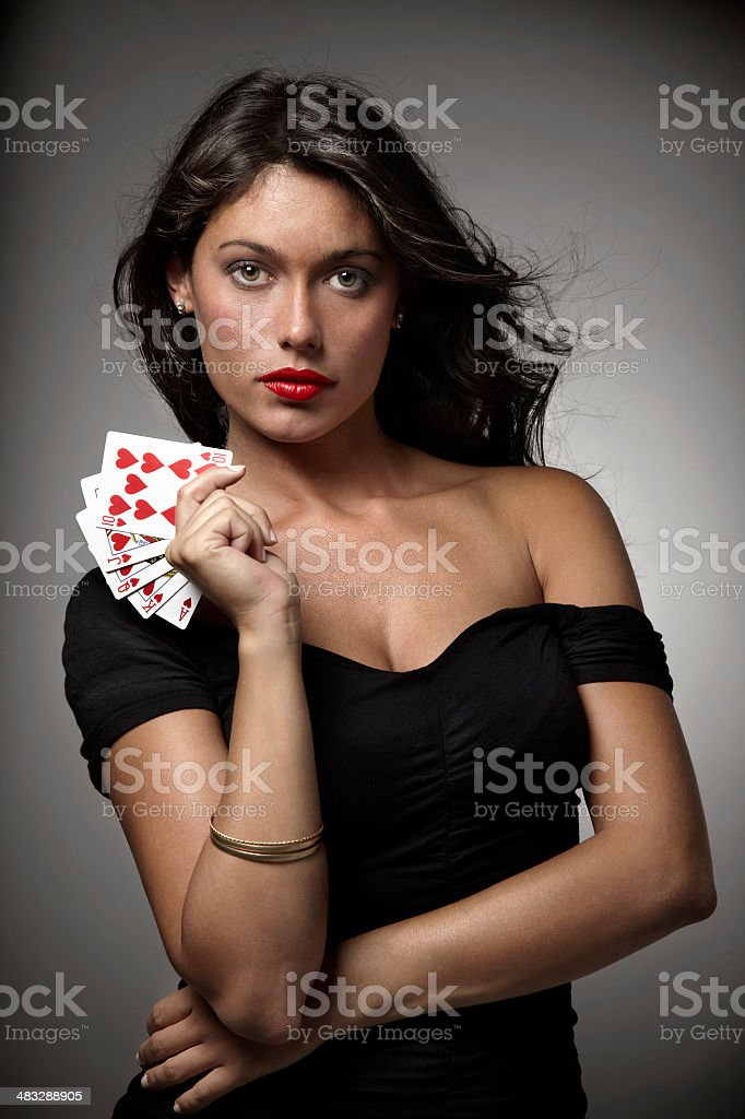 woman playing poker with straight flush stock photo