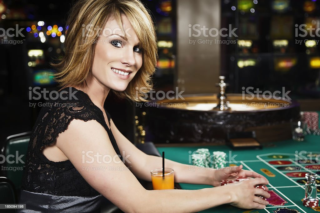 Woman Playing Roulette In a Casino royalty-free stock photo