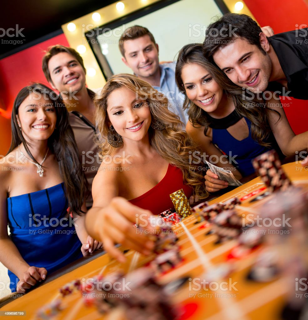 Woman playing roulette stock photo