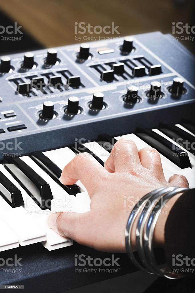Woman playing synthesizer stock photo